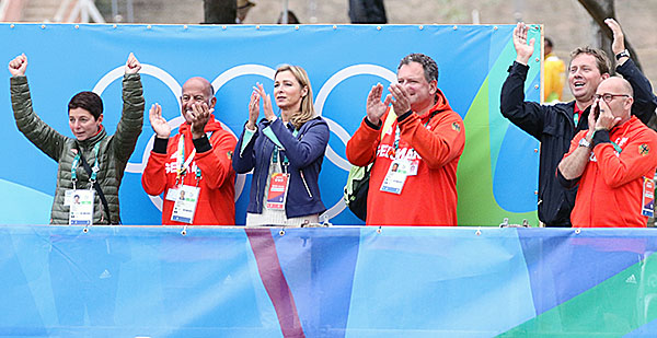 German cheering section for result of Sönke Rothenberger on Cosmo--team coach Monica Theodorescu (left) and Sönke's father, Sven (right) with arms raised in jubilation. © 2016 Ken Braddick/dressage-news.com
