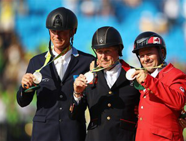 Nick Skelton of Great Britain (gold), Peder Fredericson of Sweden (silver) and Eric Lamaze of Canada (bronze) in the Olympic jumping individual competition. © Getty Images