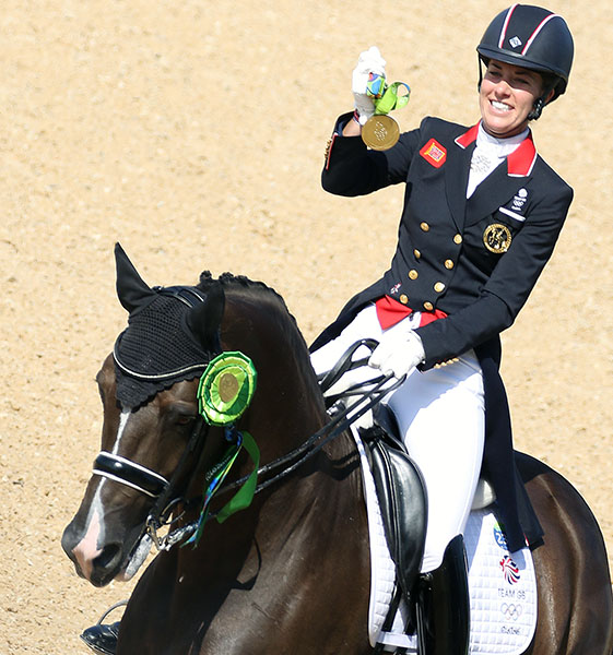 Charlotte Dujardin displaying individual Olympic gold medal won on Valegro at 2016 Games in Rio de Janeiro. Charlotte and Valegro won two individual Olympic gold medals that only two other combinations in history have achieved--Anky van Grunsven of the Netherlands on Salinero in 2004 and 2008 and Nicole Uphoff of Germany on Rembrandt in 1988 and 1992. © 2016 Ken Braddick/dressage-news.com