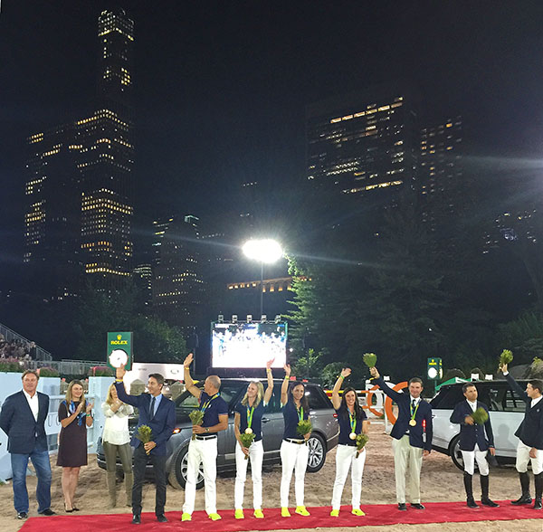 USA Olympic medalists from dressage, eventing and jumping celebrated at New York's Central Park Horse Show Friday night. A sold-out stadium with lit up skyscrapers as a backdrop paid tribute to the Americans. The USA and Germany were the only two nations at Rio de Janeiro last month to earn medals in all three disciplines. In dressage the entire team of Steffen Peters, Laura Graves, Allison Brock and Kasey Perry-Glass that won team bronze--the first dressage  medal for America since the 2004 Olympics--plus team leader Robert Dover appeared for the celebration. Phillip Dutton who won individual bronze, joined Kent Farrington and McLain Ward from the silver medal team for the event staged by Mark Bellissimo, organizer of the Rolex Central Park Horse Show, and his wife Catherine (light top). © 2016 Ken Braddick/dressage-news.com