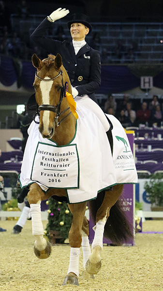 Anabel Balkenhol on Dablino FRH celebrating victory at Frankfurt CDI4*to round out most successful year for German 2012 Olympic pair. © 2016 Ken Braddick/dressage-news.com