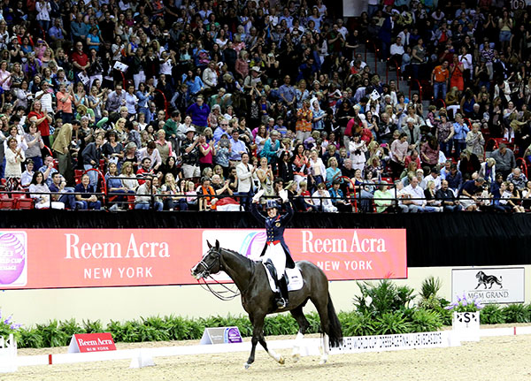 Valegro and Charlotte Dujardin applauded by spectators after their Freestyle performance at the World Cup Final in Las Vegas. © 2015 Ken Braddick/dressage-news.com