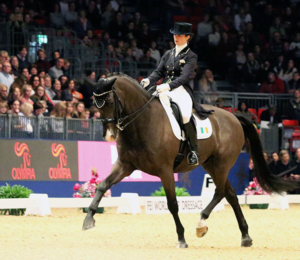 Judy Reynolds and Vancouver k riding to a medly of Christmas carols at the London Olympia World Cup event. © 2016 Ken Braddick/dressage-news.com