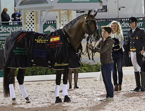 Grandioso dressed in horse blanket with the logos of the 2012 and 2016 Olympics, 2014 World Games and 2013 and 2015 European Championships in which the P.R.E. stallion competed. Kerrigan Gluch, an Under-25 rider for Hampton Green Farm, Kimberly van Kampen the owner of Grandioso and Hampton Green Farm, with Jose Daniel Martin Dockx. © 2017 Ken Braddick/dressage-news.com