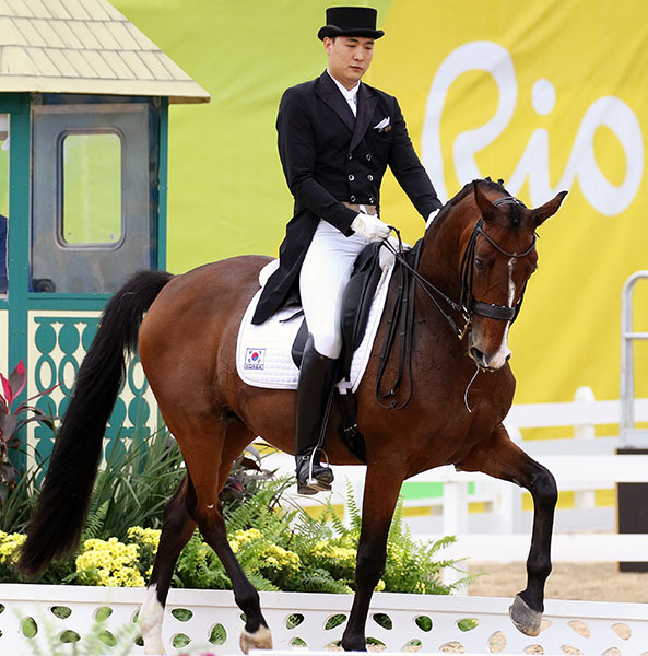 Kim Dong-seon on Bukowski at the 2016 Olympic Games in Rio de Janeiro. The rider was the second South Korean equestrian to be involved in scandal, his Asian Games team mate being detained in Denmark last week in connection with her mother's involvement with the politcally embattled president. © 2016 Ken Braddick/dressage-news.com