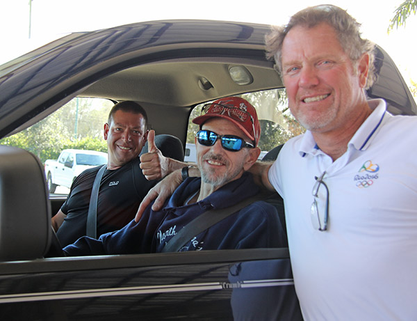 Jimmy Mandala at the wheel of his rebuilt truck with Scott Hassler, a personal supporter during the battle with pancreatic cancer, and Michael Barisone, who organized a campaign to raise funds for the project. © 2016 Ken Braddick/dressage-news.com